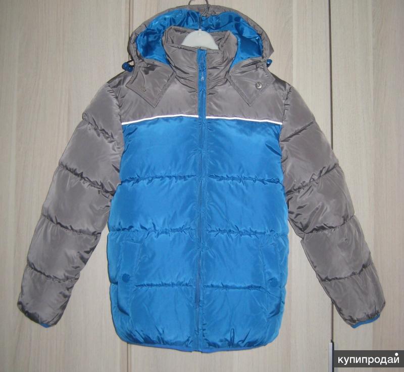 Новая зимняя куртка для мальчика на рост 140-146 см.