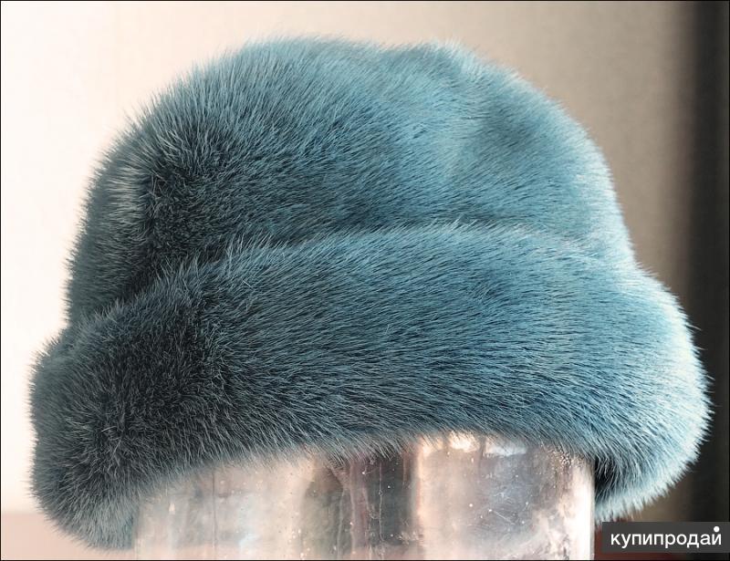 Продам меховую шапку темно зеленого цвета с оттенком морской волны