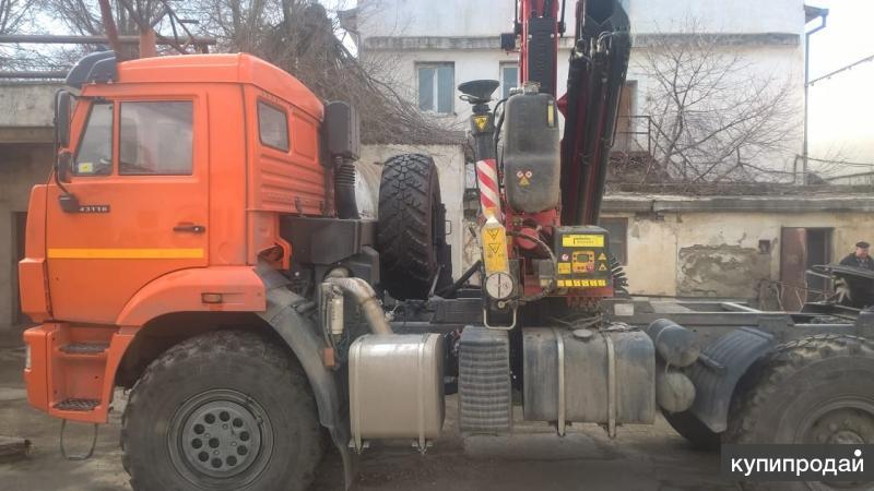Седельный тягач на шасси КАМАЗ 43118-50 с КМУ Fassi F155A.2.23 за кабиной