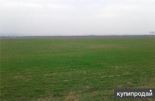 Продам участок для использования под сельхоз. 2.3 гектара.