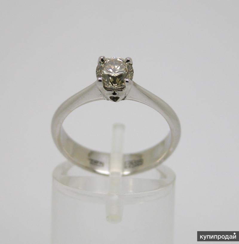 Золотое кольцо с бриллиантом 0.81 карат.